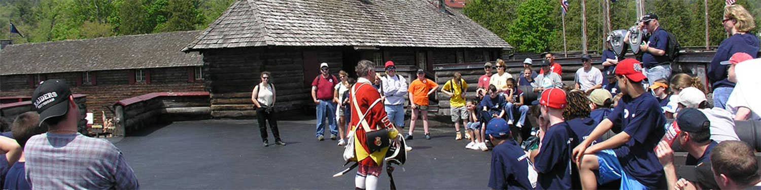 Volunteers talking to a group at Fort William Henry in Lake George, NY